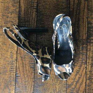 Peep toe, cheetah print, sling back heels.